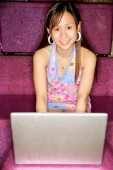 Young woman, using laptop, looking at camera - Alex Microstock02