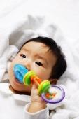 Infant boy biting toy - Alex Microstock02