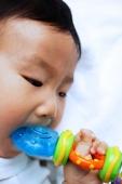 Infant boy biting toy, close-up - Alex Microstock02