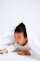 Baby boy lying on front, under blanket - Alex Microstock02
