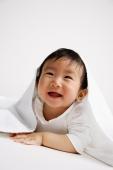 Baby boy peeking out from under blanket - Alex Microstock02