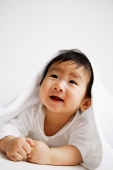 Baby boy peeking out from under blanket, portrait - Alex Microstock02