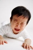 Baby boy lying on front, crying - Alex Microstock02