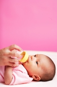 Baby lying down, drinking from bottle - Alex Microstock02