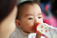 Baby girl drinking from bottle - Alex Microstock02