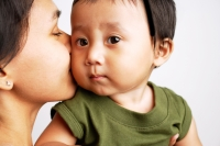 Mother kissing baby boy - Alex Microstock02