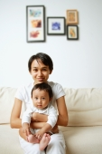 Mother with baby boy, sitting on sofa, portrait - Alex Microstock02