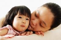 Mother next to baby girl - Alex Mares-Manton