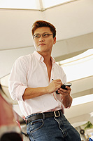Man holding PDA, looking away - Alex Microstock02