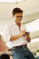 Man using PDA, looking down - Alex Microstock02
