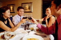 Couples in restaurant, toasting with wine glasses - Alex Microstock02
