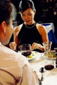 Couple having dinner, over the shoulder view - Alex Microstock02
