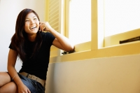 Young woman sitting, using mobile phone - Alex Microstock02