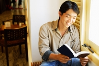 Man reading book, smiling - Alex Microstock02