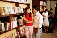 Couple at bookstore, looking at books - Alex Microstock02
