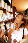 Young woman holding book, hand on chin, looking up - Alex Microstock02