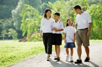 Family walking in park - Alex Microstock02