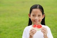 Girl holding slice of watermelon, smiling - Alex Microstock02