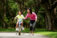 Girl on bicycle, mother walking next to her - Alex Microstock02