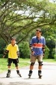 Father and son in park, on roller blades - Alex Microstock02