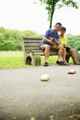 Father and son playing with remote control cars - Alex Microstock02