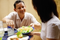 Husband serving wife salad - Alex Microstock02