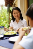 Woman having salad, smiling - Alex Microstock02