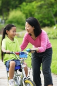 Young girl on bicycle, mother next to her - Alex Microstock02