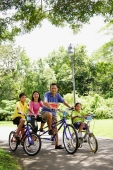 Family with two children, on bicycles, portrait - Alex Microstock02