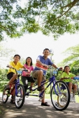 Family, on bicycles, portrait, low angle view - Alex Microstock02