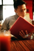Young man looking at menu - Alex Microstock02