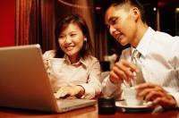 Executives looking at laptop - Alex Microstock02