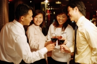 Young executives standing, toasting with wine - Alex Microstock02