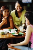 Young women eating at cafe - Alex Microstock02