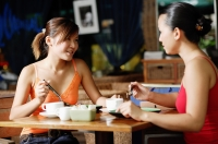 Young women at cafe, having coffee - Alex Microstock02