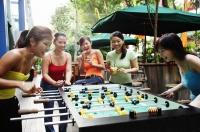 Young women playing foosball - Alex Microstock02