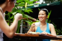 Two women at outdoor cafe, drinking coffee - Alex Microstock02