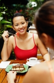 Women at cafe, eating, over the shoulder view - Alex Microstock02