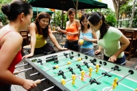Group of young women playing foosball - Alex Microstock02