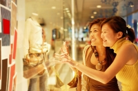 Young women, standing outside window display, looking in - Alex Microstock02