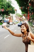 Young woman, flagging a cab - Alex Microstock02