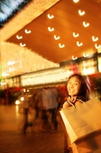Young woman, carrying shopping bag over shoulder - Alex Microstock02