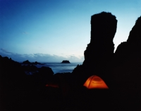 Tents under rock outcrop at night - Martin Westlake