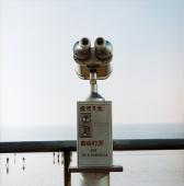 Coin binoculars on promenade, early morning - Martin Westlake
