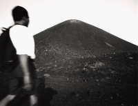 Asian male trekker on slopes of Krakatau volcano - Martin Westlake