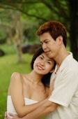 Couple embracing, woman looking at camera - Alex Microstock02