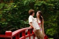Couple standing face to face on bridge - Alex Microstock02