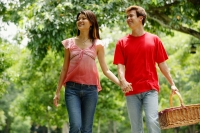 Couple holding hands, man carrying picnic basket - Alex Microstock02