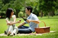 Couple in park, man pouring wine for woman, portrait - Alex Microstock02