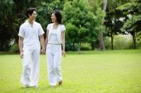 Couple holding hands, walking across field - Alex Microstock02